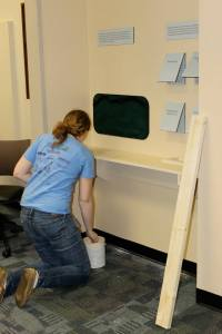 After installing the shelf it needed a few paint touch-ups. This area was my interactive corner. Photo by Dr. Tammy Gordon.