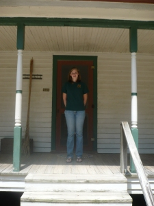 Me on the porch of the Tobacco Farm Life Museum's historic homestead. I assisted with the cleaning and repainting of one of the rooms following the removal of a bee infestation and related replastering. Summer 2010.